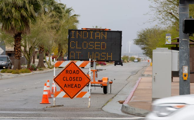 Indian Canyon at Whitewater Wash is closed due to flooding in Palm Springs, Calif., on April 7, 2020.