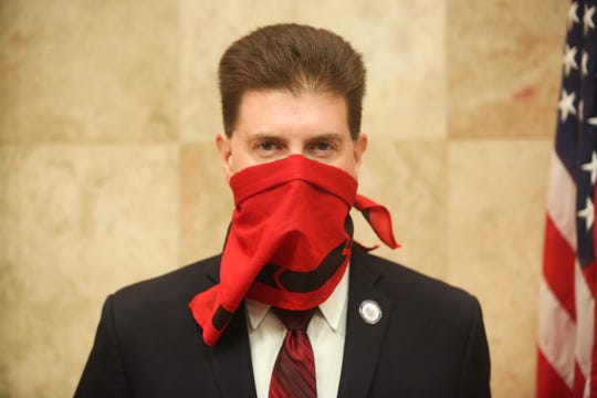 Riverside County's public health officer, Dr. Cameron Kaiser, wears a face mask to slow the spread of coronavirus at a Riverside County Board of Supervisors meeting on Tuesday, April 7, 2020 in Riverside, Calif.