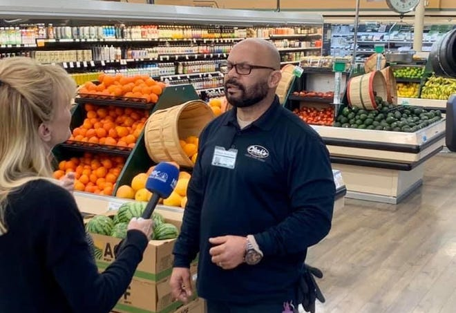 Sandie Newton gets some nutritional tips from Michael Rehm at Clark's.