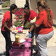 Staff and alumni of the Boys and Girls Clubs of Coachella Valley deliver food to seniors at Christiansen Senior Apartments in Indio on March 27.