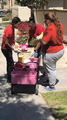 Staff and alumni of the Boys and Girls Clubs of Coachella Valley deliver food to seniors at Christiansen Senior Apartments in Indio on March 27, 2020.