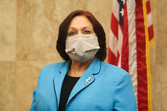 Riverside County Second District Supervisor Karen Spiegel wears a face mask to slow the spread of coronavirus at a Riverside County Board of Supervisors meeting on Tuesday, April 7, 2020 in Riverside, Calif.