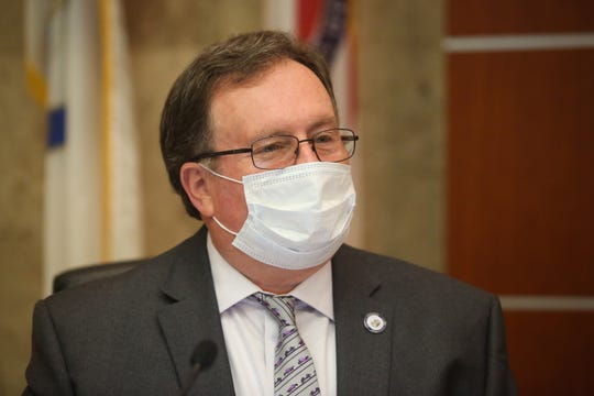 Riverside County First District Supervisor Kevin Jeffries wears a face mask to slow the spread of coronavirus at a Riverside County Board of Supervisors meeting on Tuesday, April 7, 2020 in Riverside, Calif.