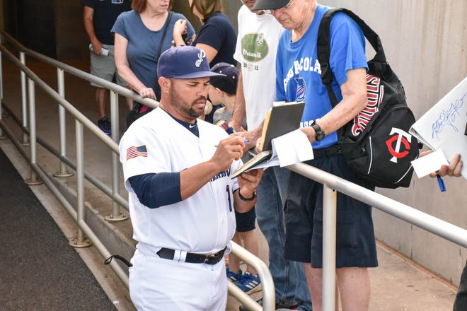 Pensacola Blue Wahoos manager Ramon Borrego signs autographs in an undated photo. Borrego is awaiting his return to Pensacola for minor league baseball amid the COVID-19 pandemic.