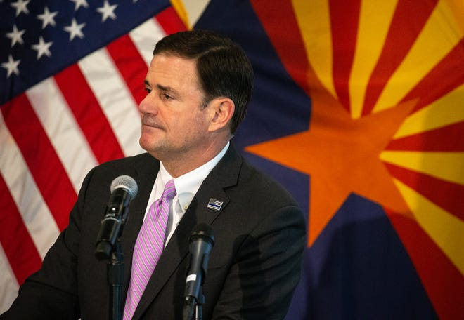 Gov. Doug Ducey listens to a question, April 7, 2020, during a COVID-19 news conference at the Arizona Commerce Authority Conference Center in Phoenix.