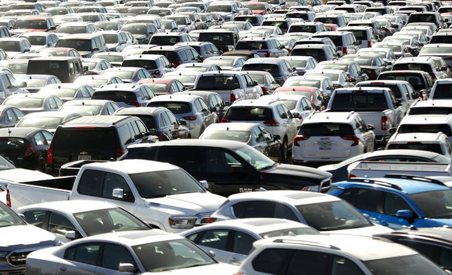More than 1,000 rental cars sit in a parking lot near Priest Dr. and Van Buren St. in Phoenix, Ariz. on April 6, 2020.