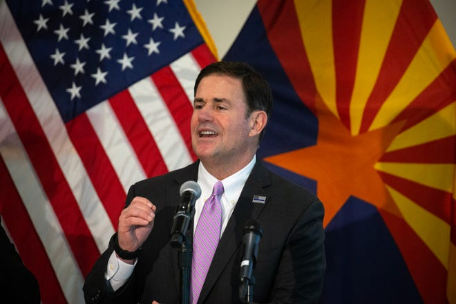 Gov. Doug Ducey answers a question, April 7, 2020, during a COVID-19 news conference at the Arizona Commerce Authority Conference Center in Phoenix.