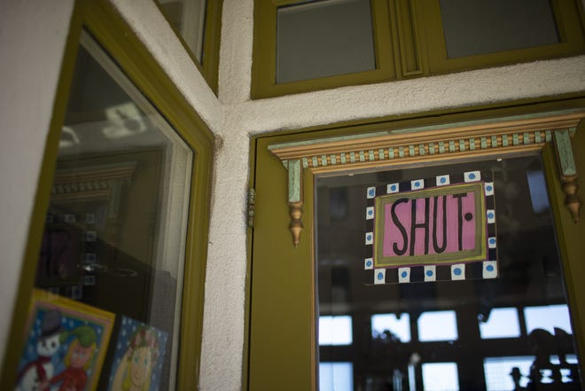 A shop hangs a closed sign in Jerome on April 7, 2020. Many shops in the Arizona tourist destination town were closed due to the COVID-19 pandemic.