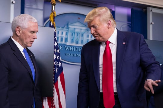 President Donald Trump departs after speaking about the coronavirus, with Vice President Mike Pence at left, in the James Brady Press Briefing Room of the White House, Monday, April 6, 2020, in Washington.