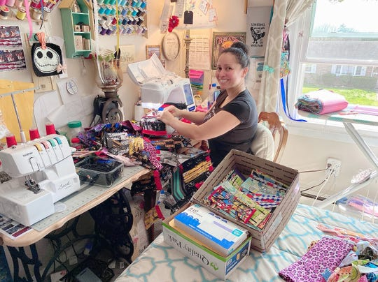 Brenda Thorp sews masks in her home in Waynesboro, Pa.