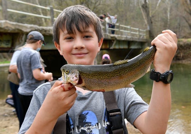 Jason Zander, 8 of Leader Heights, holds up his very first trout he caught while fishing with his brother and father at Muddy Creek Forks,Tuesday, April 7, 2020 after the PA Fish & Boat Commission surprised anglers by opening trout season across the state more than a week before the scheduled opening day. John A. Pavoncello photo