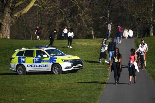A police car is seen patrolling Greenwich Park on April 5, 2020 in London, England. The coronavirus COVID-19 pandemic has spread to many countries across the world, claiming more than 60,000 lives and infecting more than 1 million people. (Peter Summers/Getty Images/TNS)