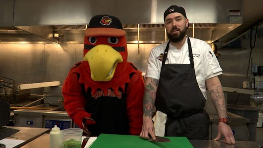Rochester Red Wings executive chef Ryan Donalty and team mascot Spikes.