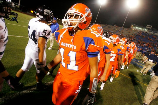 San Angelo Central's Romario Napoles shakes hands with Killeen Shoemaker players after the Bobcats' 42-7 win to open their 2010 season.