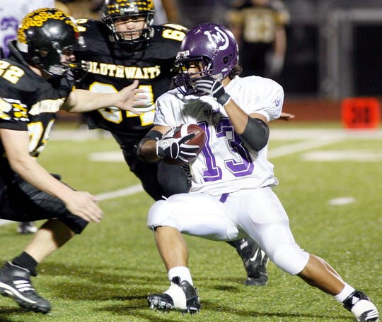 Mason High School's David Mora tries to get between Goldthwaite defenders Gary Head (22) and Chris DelaRosa in their regional final at Mustang Stadium in Marble Falls on Dec. 3, 2010.