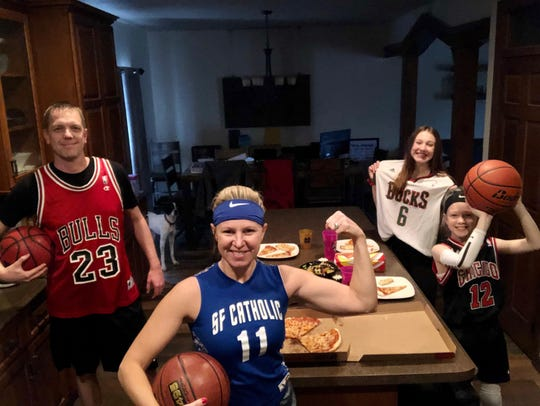 Joe, Betsy, Halle and Hayden Weber eat dinner together during their basketball-themed dinner night.