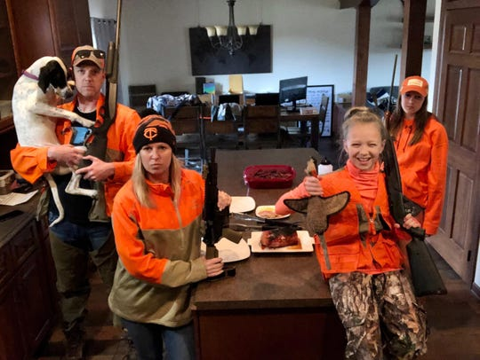 Joe, Betsy, Halle and Hayden Weber eat dinner together during their pheasant hunting-themed dinner night.