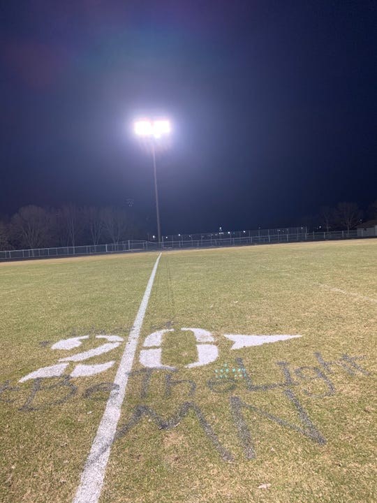 "The 20-yard line at Sauk Rapids had ""Class of"" above the number and ""#BeTheLightMN"" underneath as the Storm lit its football stadium for 20 minutes in the #BeTheLightMN movement on Monday, April 6, 2020, at Sauk Rapids Middle School."