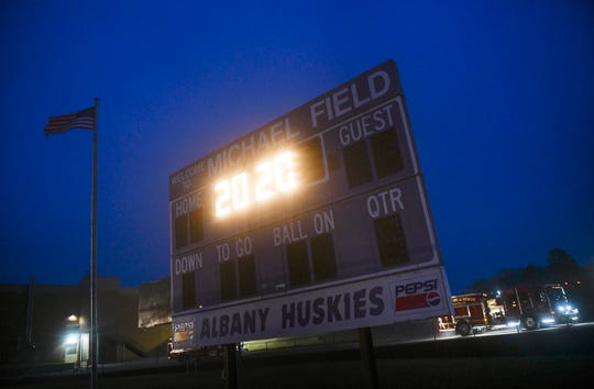 The scoreboard displays 20:20 after field lights are turned out Monday, April 6, 2020, at Albany High School.