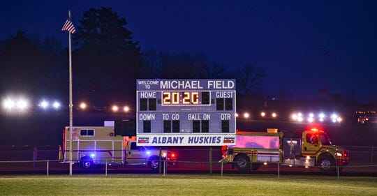 "Vehicles with headlights line the top of a hill Monday night as Albany High School's Michael Field lights are turned on for 20 minutes as part of the ""BeTheLightMN"" movement. The effort pays tribute to the Class of 2020. More than 200 schools across Minnesota were expected to take part in the effort this week. Albany and Avon fire departments also took part in Monday's tribute."