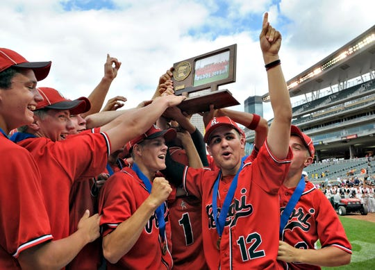 ROCORI team members celebrate with their first place trophy following the 2010 Minnesota high school baseball championship game at Target Field in Minneapolis .