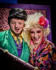 Taylor Haworth (green suit) and Jordan Hiltz, who play Mr. and Mrs. Wormwood, Matilda's parents in the Young Actors  Theatre production.