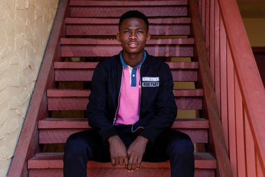 Freddy Ntanga Ntambwe, 19, works at Publix. Due to the coronavirus, his work hours have increased while his parents' have been cut, causing them to have trouble paying rent and bills. The family is now relying on Freddy to help.