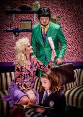 Taylor Haworth (green suit) and  Jordan Hiltz, who play Mr. and  Mrs. Wormwood, Matilda's parents, shown with Mallory Greisl as Matilda in the Young Actors production.