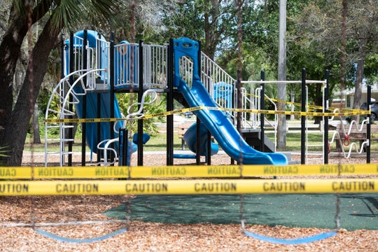 The playground at Jock Leighton Park is surrounded with caution tape Tuesday, April 7, 2020, in Palm City. Playgrounds are among a list of public amenities the Martin County commissioners announced closed during the coronavirus pandemic, also including basketball, pickleball and tennis courts, athletic fields to organized or pickup sports and park bathrooms. Boat ramps are open to the public during the week, but restricted to commercially licensed fisherman on the weekends.