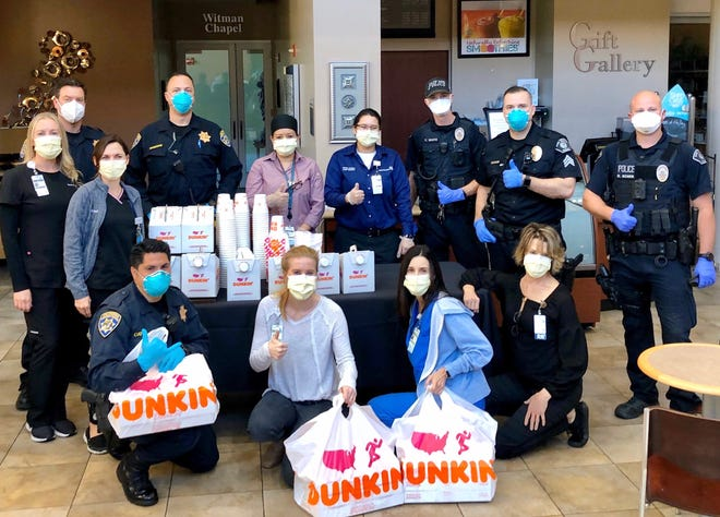 Officers from the California Highway Patrol West Valley, CHP Moorpark and the Simi Valley Police Department drop off doughnuts and coffee provided by Dunkin' Donuts at Adventist Health Simi Valley.