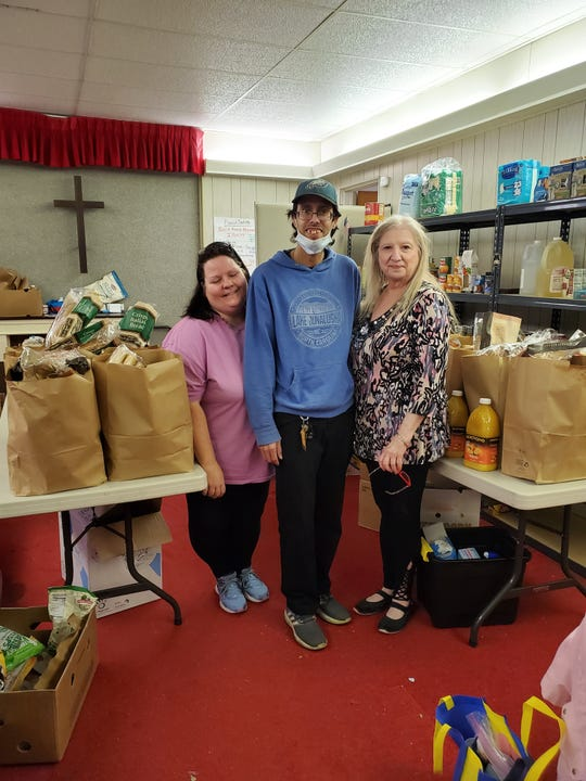 Shawn Connors, Louis Soto, and Marie Cliff were at Help & Hope Ministries in Millville assembling grocery items for home delivery on Tuesday. Connors is affiliated with Rise and Shine Ministries, which is partnering on the deliveries. Photo submitted by Chuck Brett.
