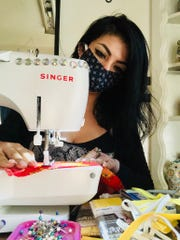 College of the Sequoias student Elizabeth Guadarrama sews some homemade masks to local health care workers. The COS fashion department has already donated several hundred masks to local health care offices and to Kaweah Delta.