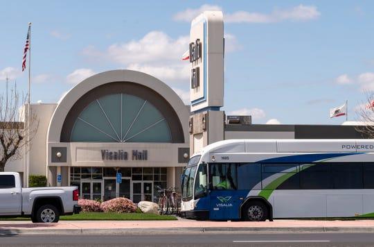 A Visalia Transit bus rolls down Mooney Boulevard near Visalia Mall on Tuesday, April 7, 2020.