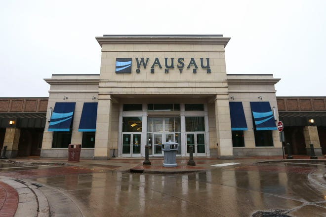 The entrance to the Wausau Center Mall, as seen on Wednesday, March 25, 2020, in downtown Wausau, Wis. The mall is currently closed due to the COVID-19 pandemic.