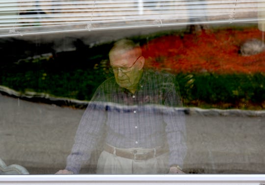 Charles Hutton, 95, a resident of Tappan Zee Manor, an assistant living facility in Nyack, N.Y. looks out the window of his room April 7, 2020. The facility has not permitted residents to have visitors since the start of the coronavirus pandemic.