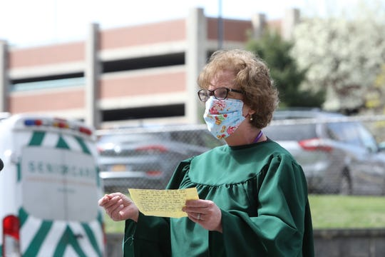 Karen Costa, a registered nurse at St. Joseph's Hospital, demands personal protective equipment (PPE) to safely care for patients and slow the spread of COVID-19 April 7, 2020 at St. Joseph's Hospital  in Yonkers.