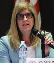 Dr. Karyl Rattay, director of the Delaware Division of Public Health, speaks as administration officials conduct a press briefing on the state's coronavirus situation Tuesday at the Carvel State Office Building.