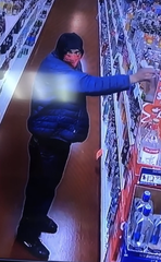 A man wearing a red mask covering the bottom half of his face stole liquor from Cypress Wine & Spirits in Milford a couple of weeks ago. The moment was captured by a security camera.