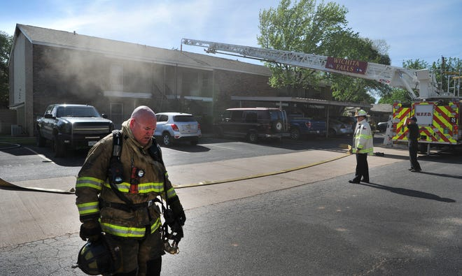 Wichita Falls firefighters work to control a 3-alarm fire Tuesday afternoon at the Raintree Apartments located in the 4500 block of Barnett Rd. The fire call came in around 4:30 p.m. as was upgraded to a 3-alarm fire shortly after the fire department arrived on-scene.