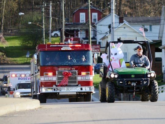 Members of the Roseville Fire Department drive down Main Street during a parade on Monday. The department wanted to raise morale in the village in light of COVID-19 and the approaching Easter holiday.