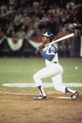 Hank Aaron hits home run #715 to break Babe Ruth's record off Al Downing on April 8, 1974.