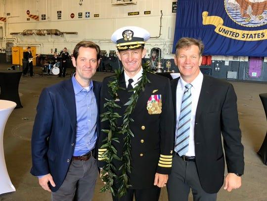 Left to right: Brett Odom, Brett Crozier and Mark Roppolo at the USS Teddy Roosevelt change of command on Nov. 1, 2019, in Coronado, California.
