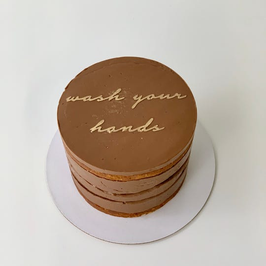 """A quarantine cake from Butter&, a bakery in San Francisco, reminds you to """"wash your hands."""""""
