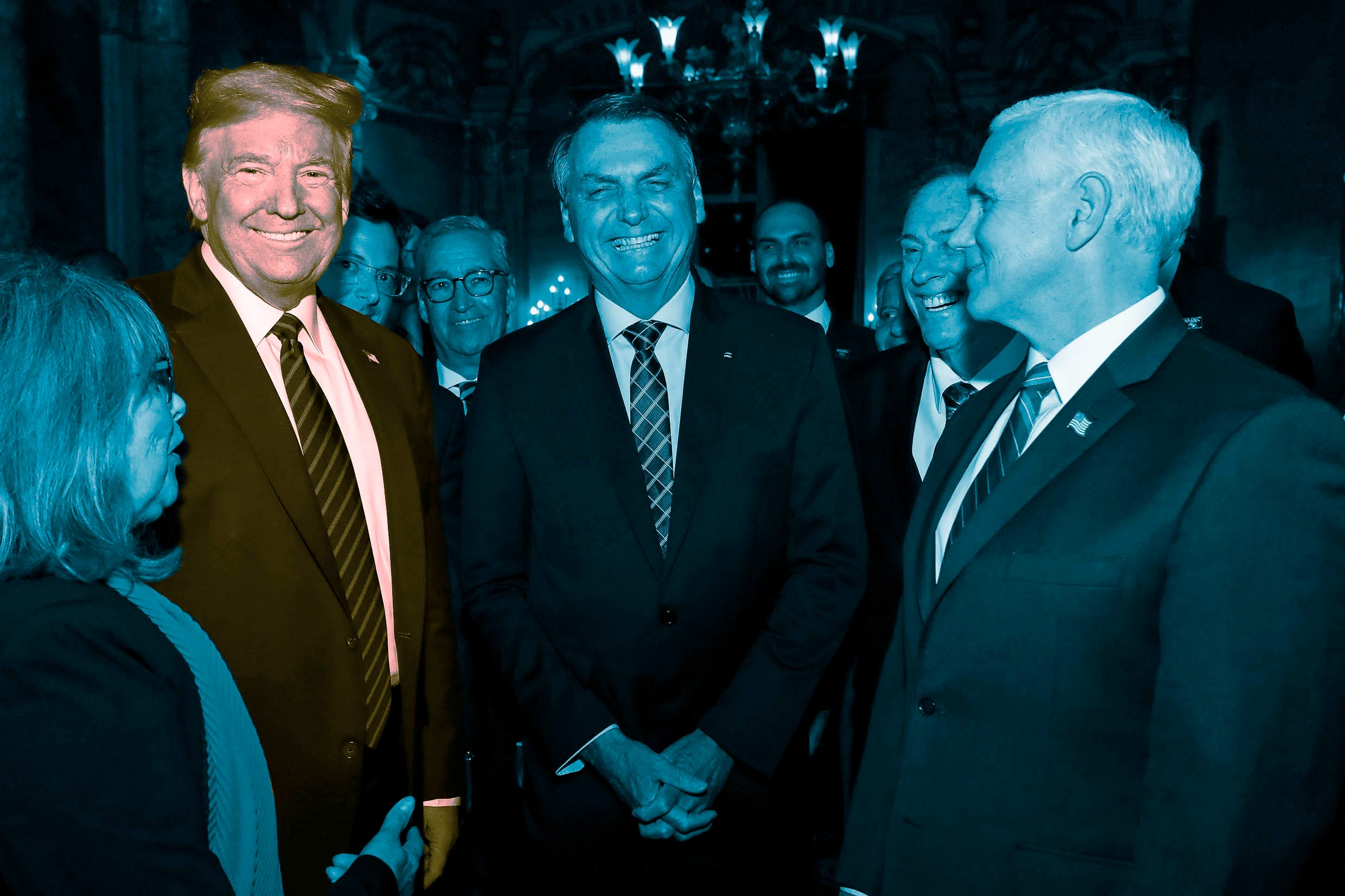 MARCH 7: Brazil's President Jair Bolsonaro, center, stands with President Donald Trump, second from left, Vice President Mike Pence, right, and Brazil's Communications Director Fabio Wajngarten, behind Trump partially covered, during a dinner in Florida.
