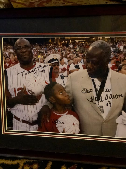 An autographed picture of Hank Aaron and Dusty Baker.