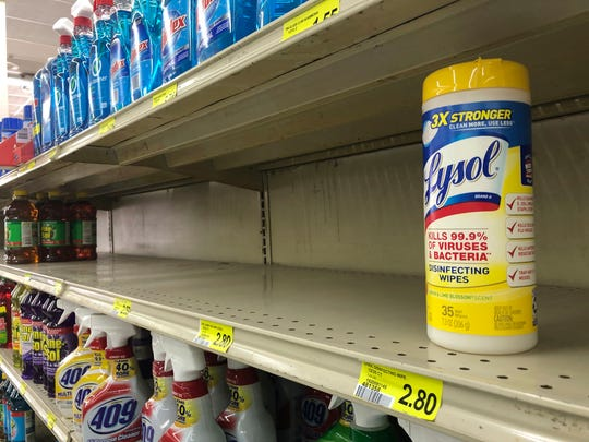 The last package of Lysol disinfectant wipes sits on a shelf at a Piggly Wiggly in Athens, Georgia on March 13. Shoppers have been snapping up disinfectants and cleaning supplies as the coronavirus spreads.