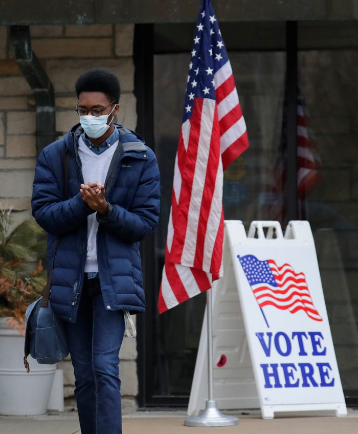 Amid vote-by-mail push, civil rights groups say in-person voting still needed during pandemic