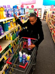 Detroit middle school principal Deborah Charaman stocks up on Lysol disinfectant spray at a CVS near downtown Detroit on March 3.