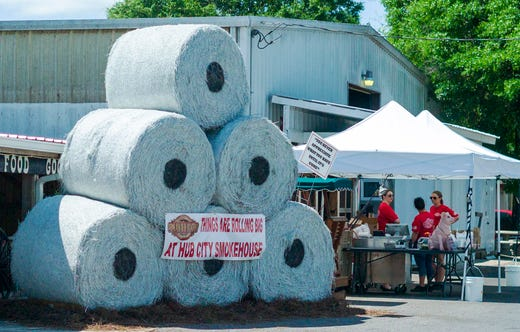 A whimsical display fashioned like giant high-demand toilet paper rolls draws attention to Hub City Smokehouse's curbside service on Main Street in historic downtown Crestview, Fla. on April 7, 2020.