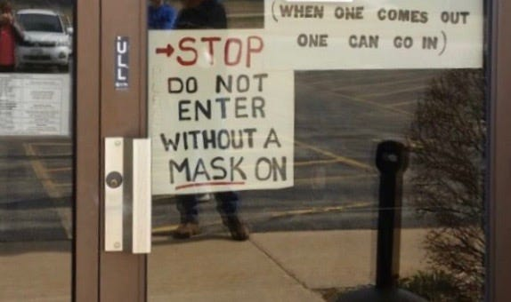 A sign outside of Ellington Town Hall on Tuesday sparked controversy with voters.